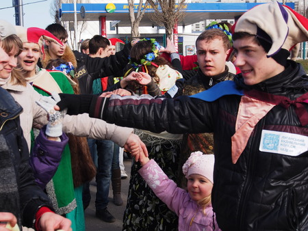 imminent: UKRAINE, LUGANSK - March 1, 2014: Maslenitsa or Pancake Week is the only purely Slavic Holiday that dates back to the pagan times. This is the celebration of the imminent end of the winter which the Orthodox Church has accommodated as a week of feasting b