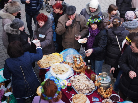 UKRAINE, LUGANSK - March 1, 2014: Maslenitsa or Pancake Week is the only purely Slavic Holiday that dates back to the pagan times. This is the celebration of the imminent end of the winter which the Orthodox Church has accommodated as a week of feasting b