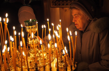 however: UKRAINE, LUGANSK - March 2, 2014: Orthodox and Greek Catholics in Ukraine celebrate Shrove Sunday. However churches are conducting solemn services prevrtilas in joint prayer for peace in the country.