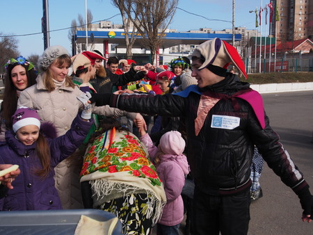 end times: UKRAINE, LUGANSK - March 1, 2014: Maslenitsa or Pancake Week is the only purely Slavic Holiday that dates back to the pagan times. This is the celebration of the imminent end of the winter which the Orthodox Church has accommodated as a week of feasting b