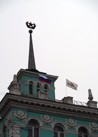 luhansk: UKRAINE, LUGANSK - March 2, 2014  Pro-Russian activists enshrined flag of the Russian Federation on the roof of the house on the Sovietskaya street in the center of Luhansk