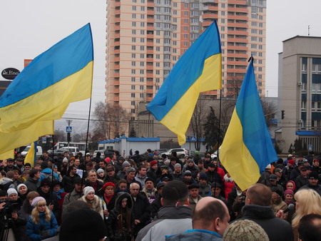 urging: UKRAINE, LUGANSK - March 2, 2014  Protesters rally in Lugansk urging Russia not to interfere in the affairs of Ukraine and other countries to send troops to the country  The rally was held under police guard  Editorial
