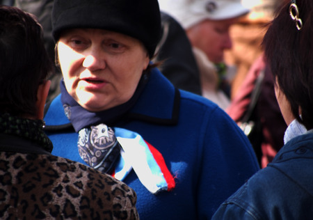luhansk: UKRAINE, LUHANSK - NARCH 15, 2014   pro-russian activist with ribbon on the colors of Russian flag  The much-touted 30000th pro-Russian rally in Lugansk failed  With all the Luhansk region  had met more than 150 collaborators
