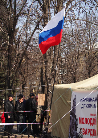 luhansk: UKRAINE, LUHANSK - NARCH 15, 2014  Russian flag on the tent pro-Russian public organization  Young Guard  in the city center  The much-touted 30000th pro-Russian rally in Lugansk failed,  had met more than 150 collaborators