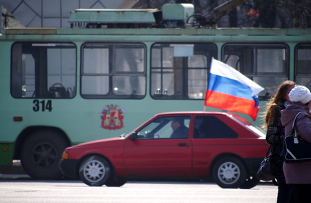 luhansk: UKRAINE, LUHANSK - NARCH 15, 2014  Motor rally collaborators under the flags of the aggressor consisted of a single old car  The much-touted 30000th pro-Russian rally in Lugansk failed,  had met more than 150 collaborators