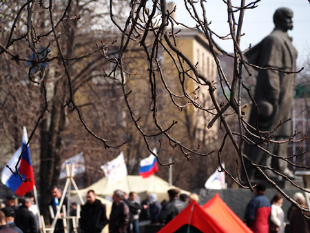 luhansk: UKRAINE, LUHANSK - NARCH 15, 2014  Few collaborators under the flags of the aggressor gathered near the monument to Ukrainian national hero Taras Shevchenko Editorial