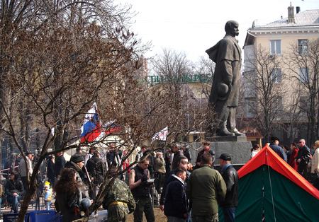 UKRAINE, LUHANSK - NARCH 15, 2014  Few collaborators under the flags of the aggressor gathered near the monument to Ukrainian national hero Taras Shevchenko Editöryel