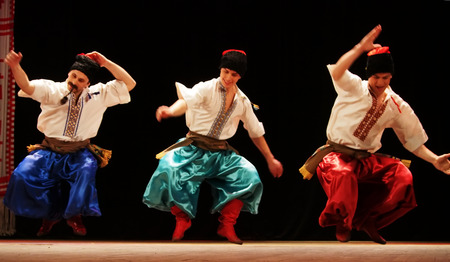 luhansk: UKRAINE, LUGANSK - MARCH 18, 2014: The Ukrainian National Folk Dance Ensemble named After P. Virsky, who is considered the best folkloric ballet dancer in the country, performed a live show on stage in Lugansk