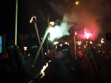 torchlight: Kiev, January 1, 2015. The torchlight procession in honor of the birthday of Stepan Bandera was held in the city center. It was attended by about four thousand people - more than two times less than a year ago. In the march was attended by two parties -