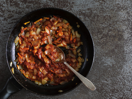 stewing: Top view of Stewed carrot and onion on pan on a black stone table