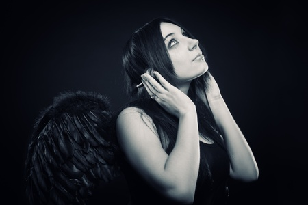 Pretty angel listening gothic music Stock Photo - 12087767