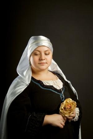 xv century: Medieval european woman posing over dark background. XV century.