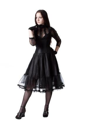 Pretty gothic girl in black dress posing over white photo