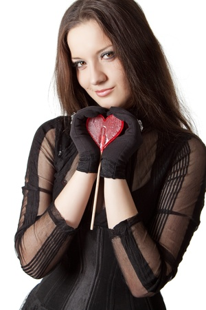 Gothic girl with lollipop in her hands. Isolated over white. photo
