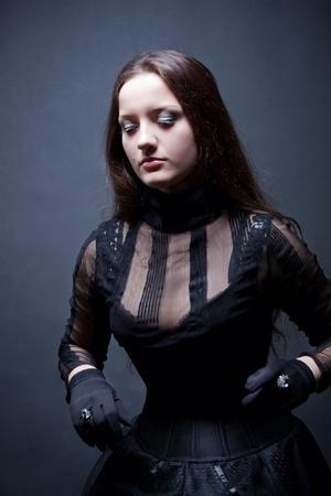 Pretty gothic girl in corset photo