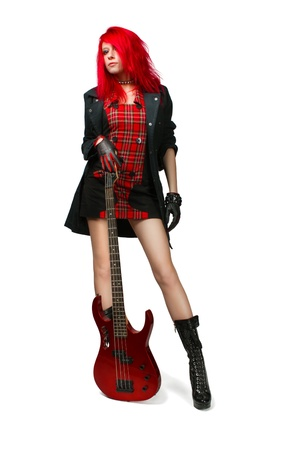 Redhead rocker girl with guitar posing over white.