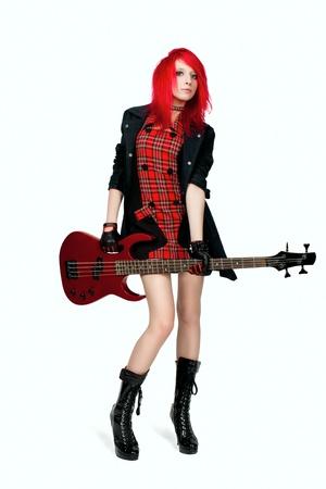 rocker girl: Redhead chica rockera posando sobre fondo blanco Foto de archivo