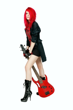 Redhead rocker girl posing with guitar over white photo