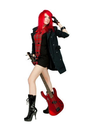 Redhead rocker girl with guitar posing over white photo