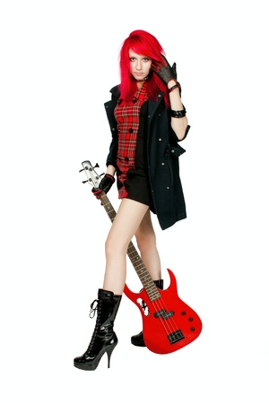 Redhead rocker girl posing over white background photo