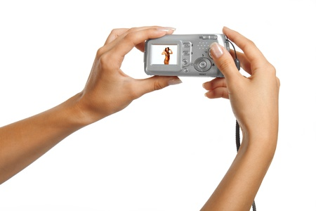 Hands holding camera over white background Stock Photo - 12148513