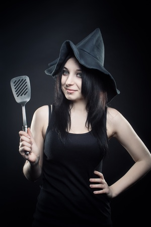 Pretty witch posing over dak background Stock Photo - 12162076