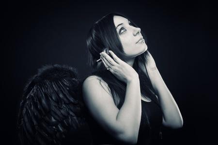 Pretty angel listening gothic music Stock Photo - 12161795