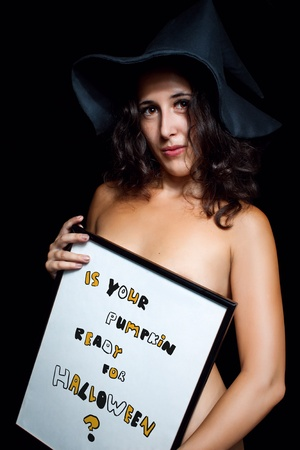 Pretty naked girl posing over dark background with sign photo