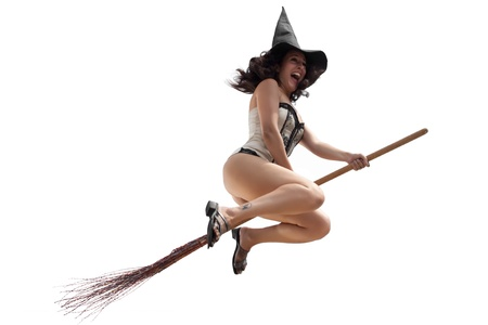 wizardry: Funny witch flying on broom over white background