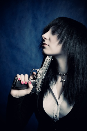 Pretty gothic dark haired girl killing herself photo