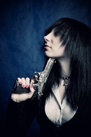 Pretty gothic dark haired girl killing herself photo