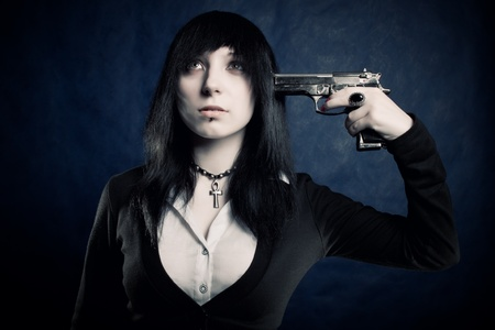Pretty gothic dark haired girl going to kill herself Stock Photo - 12161803