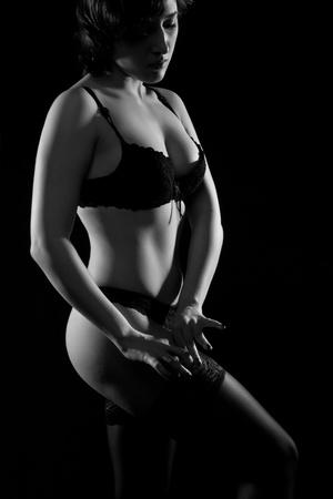 pretty sexy girl in underwear posing over dark background photo