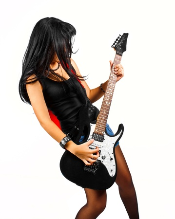 Pretty girl with guitar posing over white photo