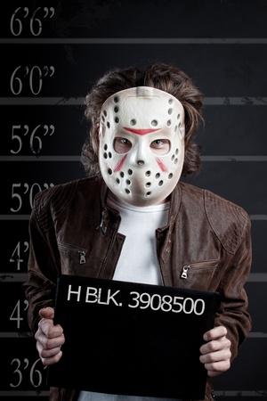 incartade: Mugshot Prisonnier de maniaque dans le masque Banque d'images