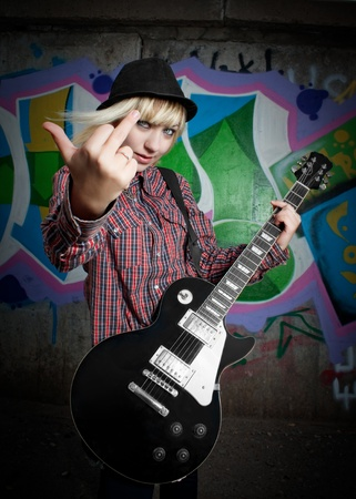 Fury rocker girl with electric guitar Stock Photo - 12386686