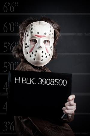 Prisoner mugshot of maniac in mask Stock Photo - 12862008