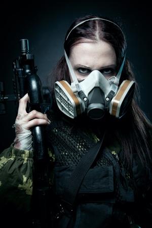 killer: Military girl with fn p90 posing over dark background Stock Photo