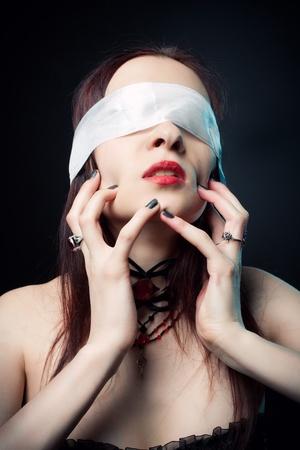 gothic fetish: Gothic girl posing over dark background