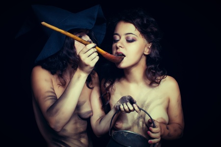 Two sexy dirty nude witch having a breakfast photo