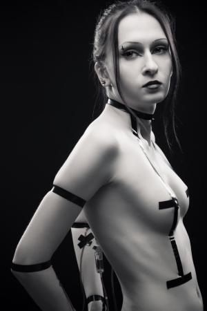 Pretty gothic sexy girl posing over dark background