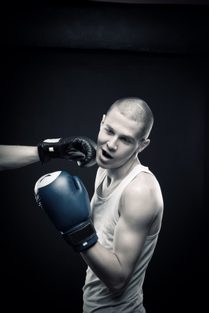 Boxer is knocked out by another one Stock Photo - 13786083