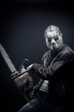 Mad man with chainsaw Stock Photo