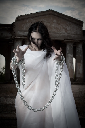 female prisoner: Pretty ghost with arms in chains
