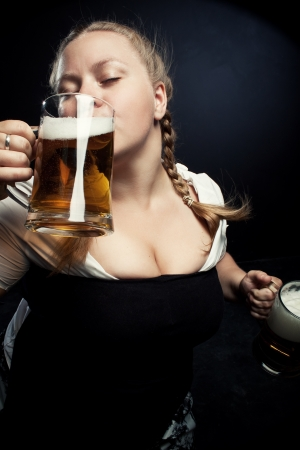 Pretty Irish girl drinking girl over dark background photo
