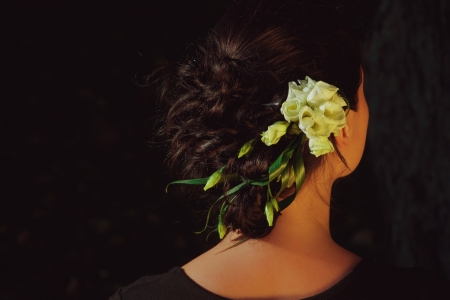 Pretty girl with flower in her hairs posing outdoor photo