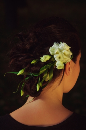 Pretty young woman with flowers in her hairs posing outdoor photo