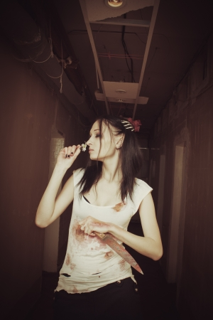 Seductive gothic girl with chamomile and knife photo