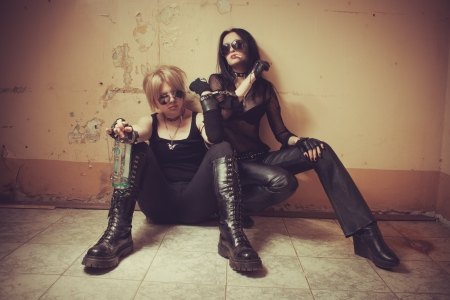 Two young seductive gothic girl sitting on the floor Stock Photo - 16859073