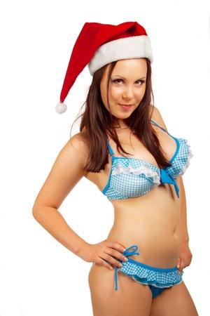 Seductive Santa helper in bikini isolated over white background Stock Photo - 16995958